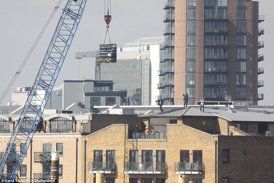 Piano floats above London in spectacular crane delivery